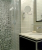 Oversized glass subways plus tumbled glass mosaic in shower